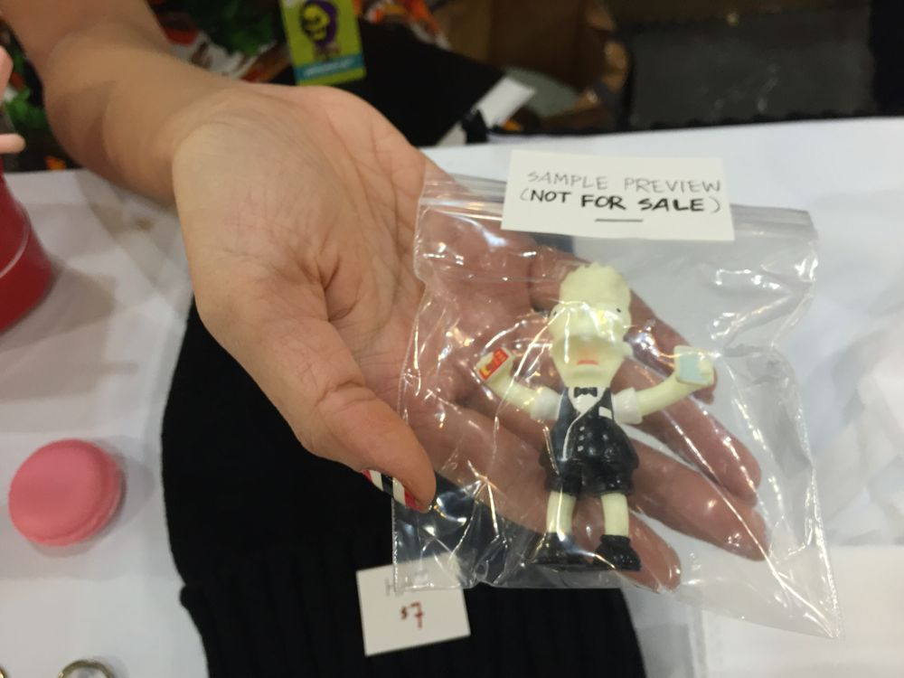Agent Wednesday holds a One Dollar Man figure that will be released in February. (Photo: Liz Ohanesian)